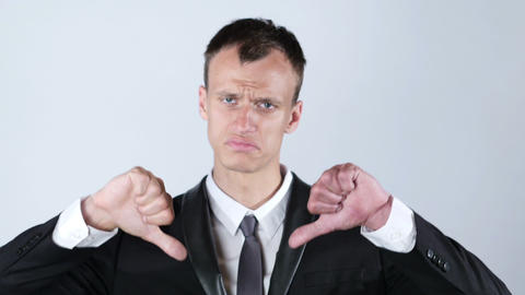 Businessman making thumbs down gesture with both hands Footage
