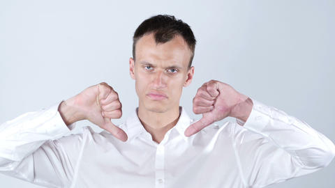 young business man showing double thumb down while looking at the camera Footage
