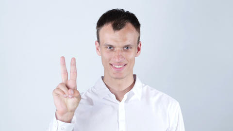 Young Businessman showing victory sign Footage