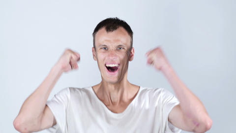 Happy excited young man celebrating success , joy , excitement Footage