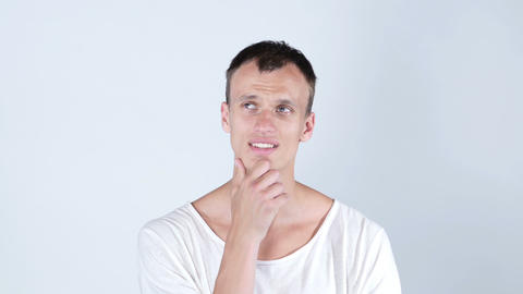 Thinking positive young man portrait. Isolated studio... Stock Video Footage