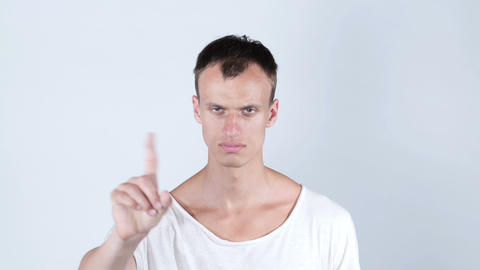 "portrait young bald man making ""NO"" gesture. emotions Footage"