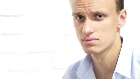 Portrait of unhappy, sad , stressed , depressed serious businessman Footage