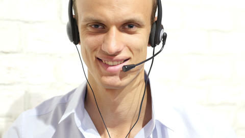 Customer service representative wearing a headset at the office , call center Footage