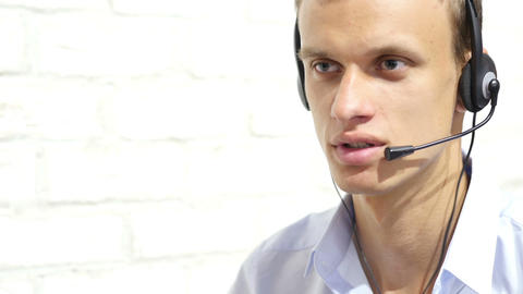 Smiling businessman with headset interacting in his office , call center concept Footage