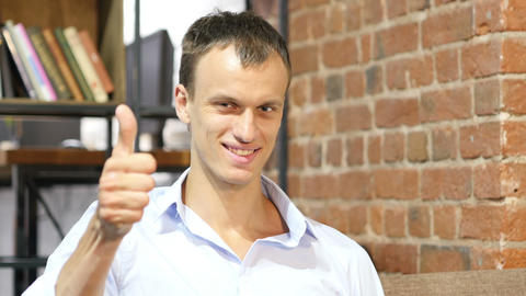 business and office concept - handsome buisnessman showing thumbs up Footage