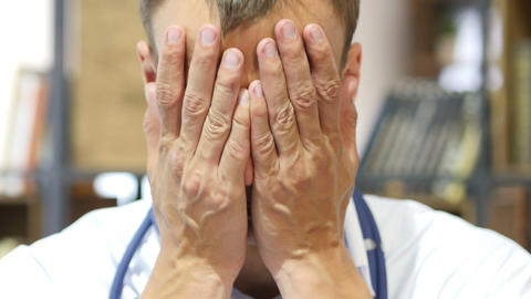 caucasian man doctor surgeon medical worker Tired at Work, Portrait Footage