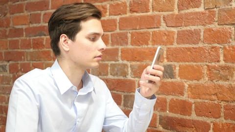 Young Businessman with smartphone , internet online email sms Footage