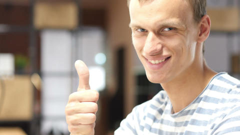 Close Up Of Young Successful Man, Showing Thumbs Up In Office stock footage