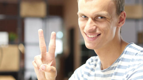 Young Designer in office showing victory sign, Successful Project Completion Footage