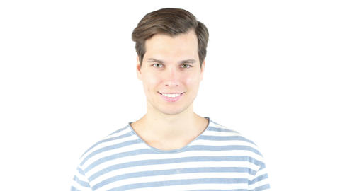Closeup of happy smiling guy looking at camera isolated on white background Footage