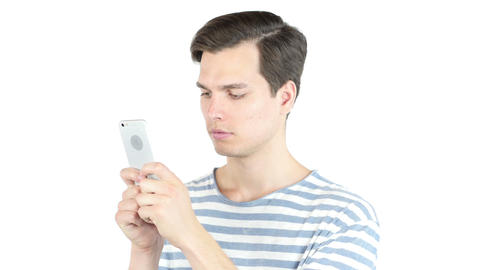 Young man typing email ,sms ,massage on smart phone , isolated white background Footage