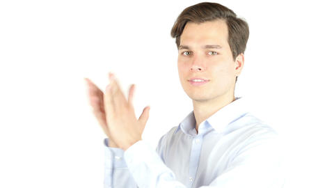 Portrait of a happy businessman clapping hands isolated on a white background Footage