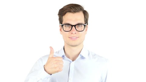 A portrait of a young businessman posing on the white background, thumbs up Footage