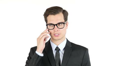 Portrait of confident handsome businessman speaking on smartphone Footage