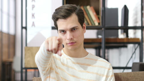 Young man points his finger at you , selection Footage