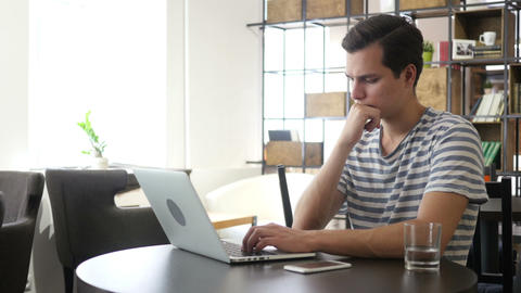 Young man with notebook laptop working on work place, Typing, Thinking Footage