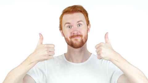 Cheerful red hair man thumbs up posing and smiling at camera , white background Footage