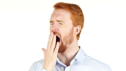 Tired businessman yawning against a white background Footage