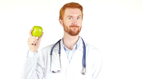 Smiling Doctor showing green apple to the camera Footage