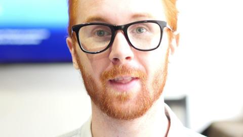 Closeup of serious man wearing eyeglass at work Footage