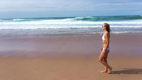 Relaxing summer holiday at the beach - cute girl at the ocean Footage