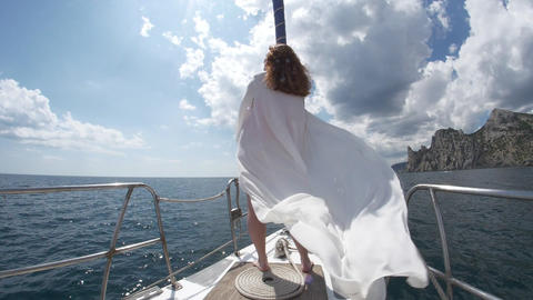 Enjoyment by travel in vacation by young woman White yacht is heading to wide Live Action