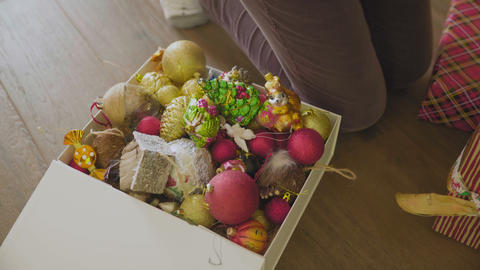 Large box with Christmas decorations GIF