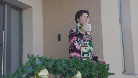Woman drink cacao in the backyard in Christmas holiday Live Action