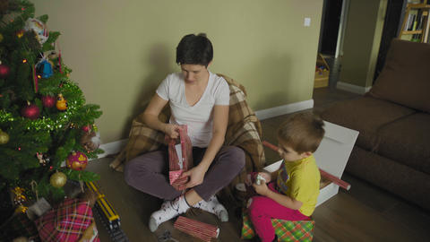 Mother and son preparing a gifts for christmas GIF