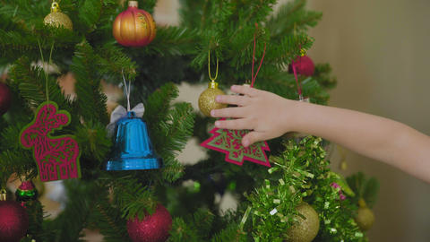 Mother and child decorate the Christmas tree together at home GIF