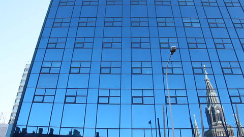 Skyscraper in Lodz. Tall skyscraper with blue windows in Lodz Live Action
