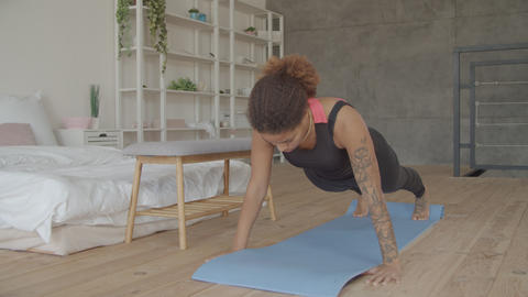 Motivated sporty black female in plank position Footage