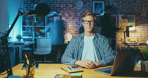 Time lapse of young manager working in office at desk late in the evening Footage