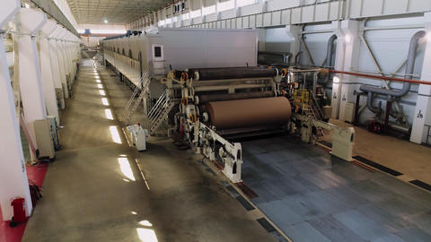 roll of brown paper in machine tool in empty workshop Footage