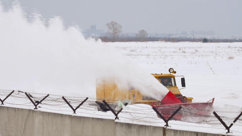 Snowplow clears the runway Live Action
