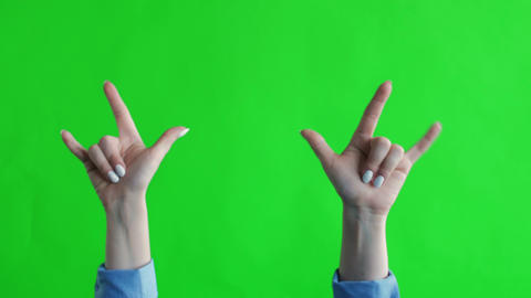 Sign of the horns with fingers on green screen. Simbol of heavy metal rock GIF