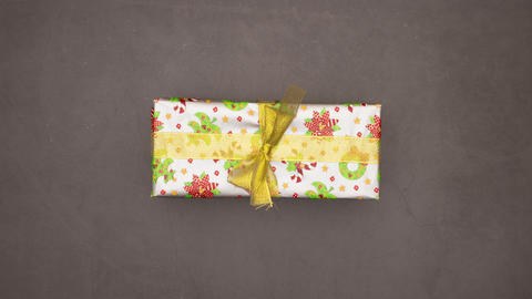 Stop motion animation of different Christmas presents changing quickly on grey background Animation