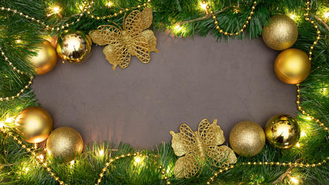 Looping Christmas decorative frame with gold ornaments and blinking lights Animation