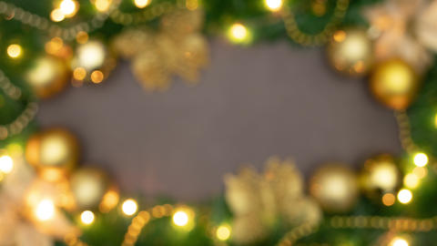 Stop motion animation of focusing beautiful Christmas frame with gold ornaments and lights Animation
