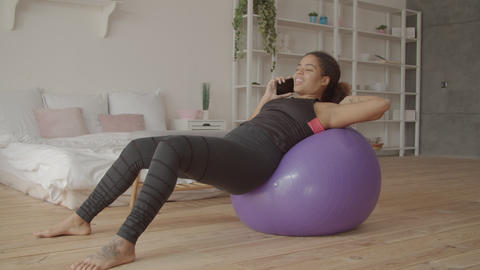 Relaxed woman chatting on cellphone after workout Footage