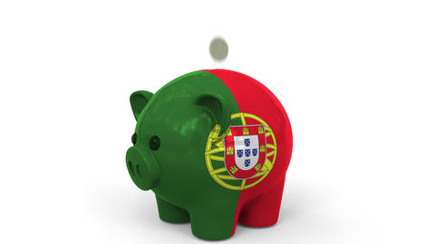 Coins fall into piggy bank painted with flag of Portugal. National banking Live Action