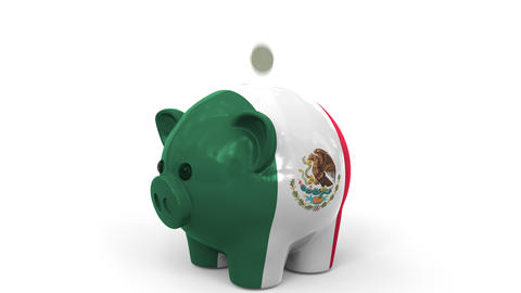 Coins fall into piggy bank painted with flag of Mexico. National banking system Live Action