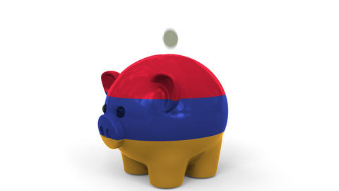 Coins fall into piggy bank painted with flag of Armenia. National banking system Live Action