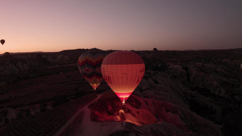 Flying drone over the balls early in the morning. Balloons fly over Cappadocia Live Action