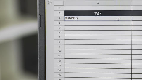 Person marking task BUSINESS MEETING in online plan, to-do list Live Action