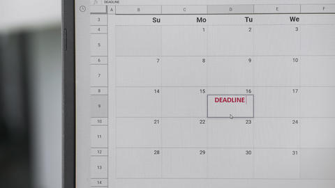 Writing red DEADLINE on 16th on calendar to remember this date Live Action