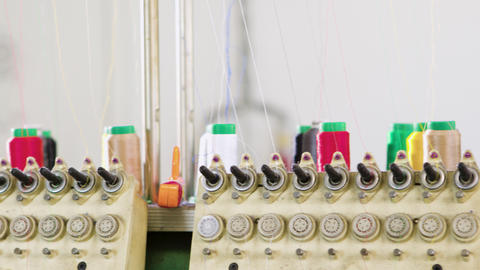 Modern industrial equipment for sewing in a clothing factory Footage