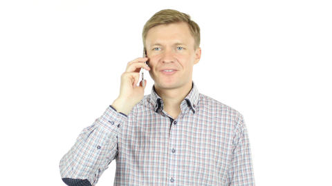 Man talking on a cell phone with a serious look of face Footage