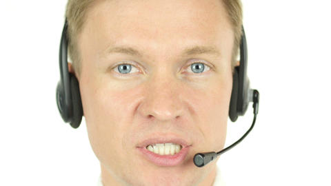 Agent Face Talking, working in a call centre with his headset Footage
